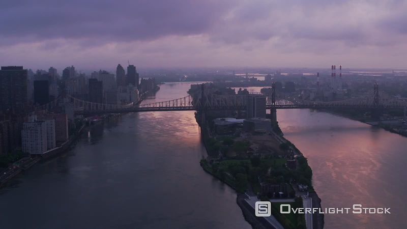 New York City Flying up East River over Roosevelt Island and Queensboro Bridge at sunrise.  Shot with Cineflex and RED EpicW Helium.