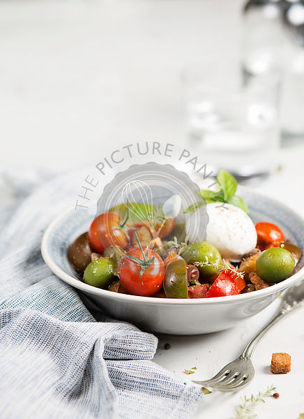 Caprese salad over white table