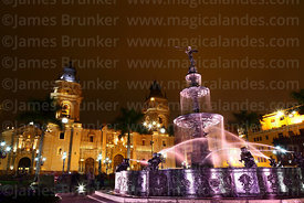 Fountain and cathedral at night, Plaza de Armas, Lima, Peru