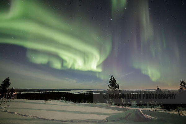 The Northern Lights on a full Moon night near Inari