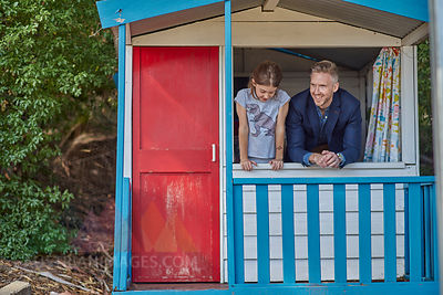 Father and daughter inside playhouse