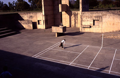 India - Chandigarh - A man bowls a cricket ball to his friend in Chandigarh