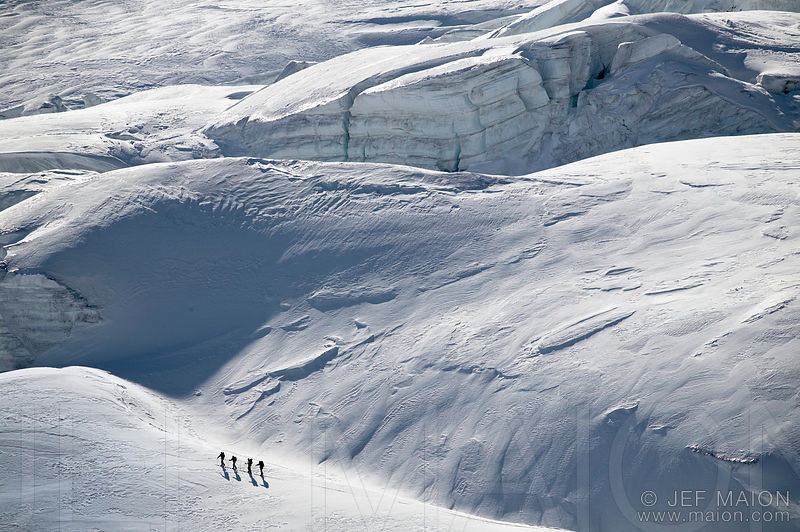 Alpine touring skiers on glacier
