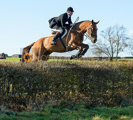Mark Kyle jumping a hedge at Barrowcliffe Farm 18/11