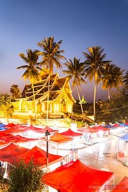 Laos, Luang Prabang. Wat Mai temple and night market, at dusk