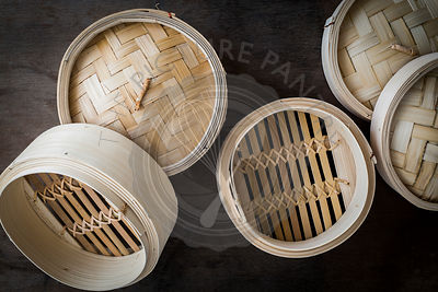 Bamboo steamers on wooden tabletop.Top view