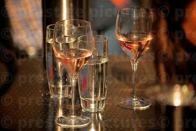 Two glasses of Rose Wine and Two of Water on a Table