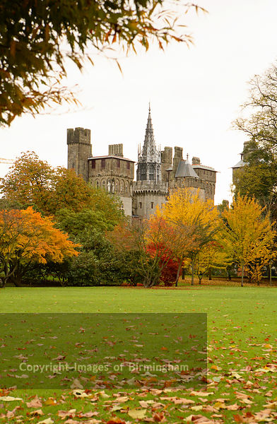 Cardiff Castle stands alongside Bute Park during autumn. Cardiff, Wales, Cymru, UK