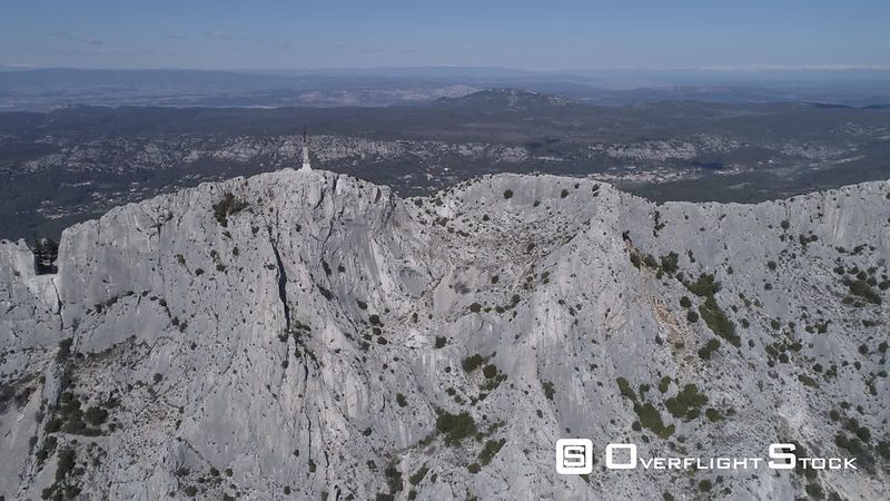 Aerial view of Sainte-Victoire mountain at Croix de Provence peak, filmed by drone, France