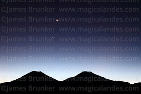 2 day old new moon, Venus and Jupiter above Payachatas volcanos after sunset, Sajama National Park, Bolivia