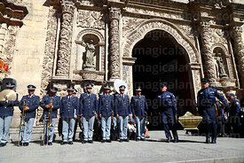 Members of the national guard carry caskets in honour of the members of the Junta Tuitiva out of San Francisco church after mass for a civic ceremony to commemorate the uprising of July 16th 1809, La Paz, Bolivia