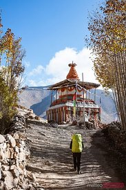 Hiker near small stupa, Upper Mustang region, Nepal