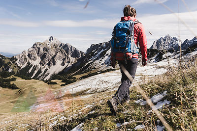 Austria, Tyrol, young woman hiking in the mountains