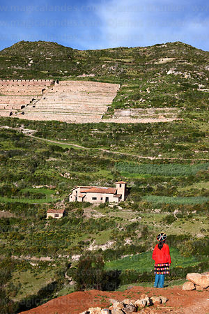 Young Quechua girl and Inca ruins of Machuqolqa / Machucollpa near Chinchero, Cusco region, Peru
