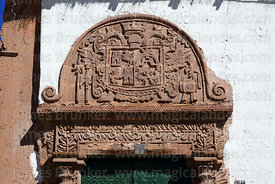 Detail of ornate carved stone family crest on doorway of Casa de la Inquisición, Plaza de Armas, Juli, Puno Region, Peru