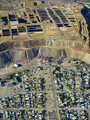 The town of Bisbee in contrast with the heap Leaching pad,  Bisbee, Cochise County, Arizona,  USA