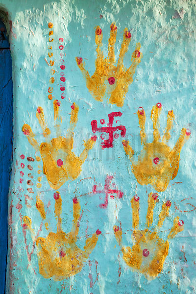 Hand Printa and a Hindu Swastika on the Entrance to a Home