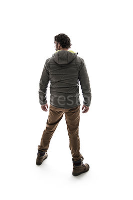 A man in outdoor clothing from behind, in semi-silhouette – shot from eye level.