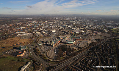 aerial photograph of the Trafford Centre with Manchester City Centre in the background