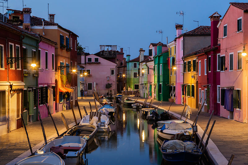 Colorful Houses along a Canal in Burano at Dusk