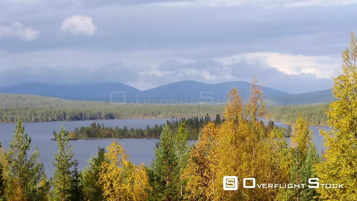 Autumn Color Landscape, Time Lapse of Autumn Trees, a Lake and Fjeld Tunturi Mountains, on a Sunny and Rainy Fall Day, in Sarkijarvi, Near Pallasyllas National Park, Lapland, Finland