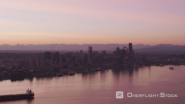 Seattle, Washington Aerial view of ship in front of Seattle skyline at sunrise.  Shot with Cineflex and RED EpicW Helium.