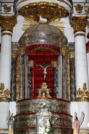 Crucifix and silver sacristy on main altar of church of Santiago the Apostle / Immaculate Conception, Lampa, Peru