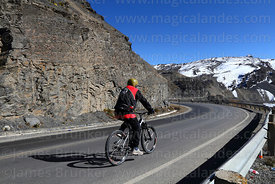 "Mountain biker below La Cumbre at start of ""The Worlds Most Dangerous Road"", Bolivia"