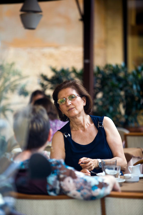 Italy - Verona - Two women talk at the table of a restaurant