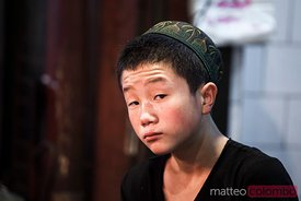 Portrait of young boy in the muslim quarter of Xian, China