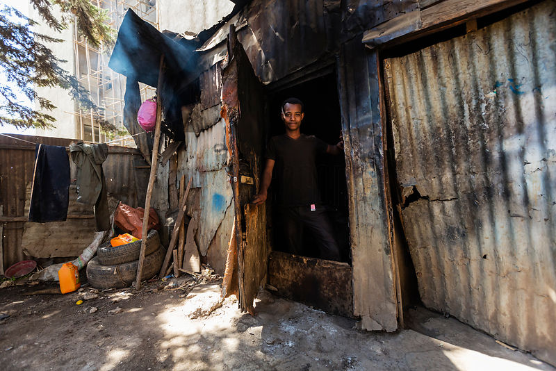 Young Man at the Door of his Tin Shanty
