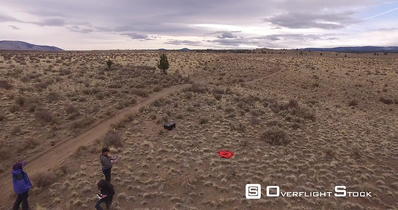 2 ATVs and 2 dirt bikes riding desert trails, Bend, Oregon
