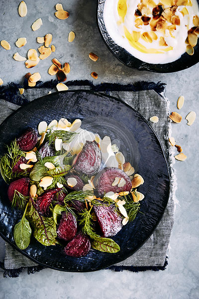 roasted beetroot salad with yogurt dressing, dill, spinage and toasted almonds.