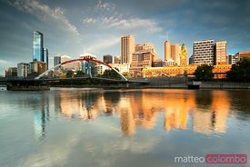 Melbourne cityscape by the the Yarra river at sunrise Australia