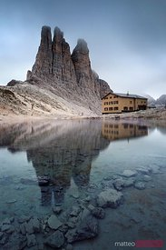 Vajolet towers peaks in the Dolomites reflected in small alpine lake