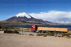 Truck on Highway 11 passing Lake Chungará, Parinacota volcano in background , Lauca National Park, Region XV, Chile