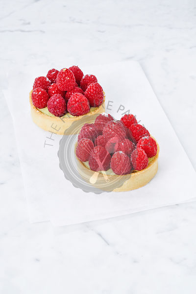 Two raspberry tarts, elevated view