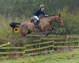 Eliza Stoddart jumping a hedge at Town Park Farm