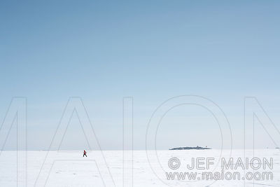 Snowshoer on frozen sea expanse