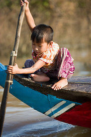 Young child paddling a boat