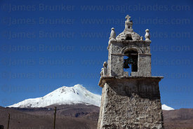 Guallatiri village church bell tower , Guallatiri volcano in background , Las Vicuñas National Reserve , Region XV , Chile
