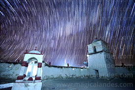 Star trails above church belfry and cairn in Parinacota village, Lauca National Park, Region XV, Chile