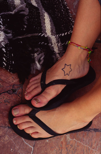 The feet of a Reveller at a carnival in Las Palmas
