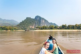 Tourists crossing Mekong river on a boat, Laos