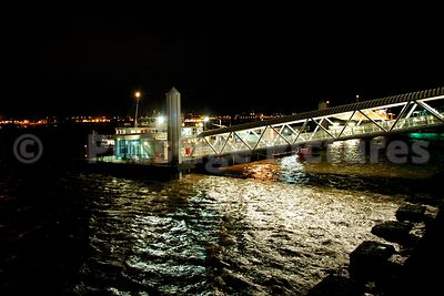 Water Swirling round the The Mersey Ferry Terminal at Pier Head at Night