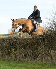 Graham Smith jumping a hedge