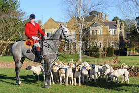Huntsman and Master Andrew Osborne MFH with the Cottesmore hounds in front of Burrough House 17/12