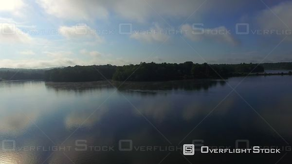 Aerial Over Misty Lake At Sunrise By Power Plant
