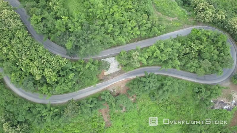 Aerial view of a Hairpin Curve of a road in the mountains nearby Xiang Ngeun, filmed by drone, Luang Prabang Province, Laos