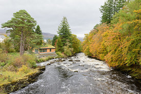 A modern timber clad new house on the banks of the river Dochart in Killin, Scotland.